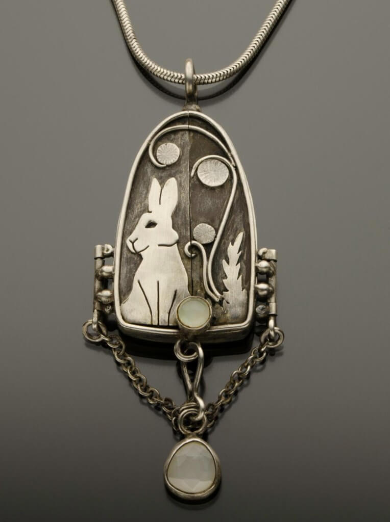 locket with rabbit and moonstone